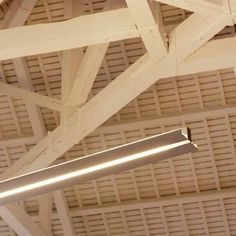 EDUARDO SOUTO DE MOURA - 'MGB' Pendant linear luminaire, direct and indirect light, in aluminium profile, with clear acrylic protection diffusers for indirect light and frosted diffusers for direct light. Multiwatt electronic power supply included. Supplied with clear base, power supply cable and 2000 mm long steel suspension cables.