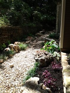A dry creek bed in Central Austin. This is complete with a variety of plants for sun and shade in and among large and medium size limestone boulders. (another angle)