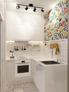 Modern Kitchen Injecting Color Into A Tiny White Space More - Don't feel limited by a small kitchen space. Here are fifty designs for smaller kitchen spaces to inspire you to make the most of your own tiny kitchen. Micro Apartment, Small Apartment Kitchen, Cozy Apartment, Apartment Ideas, Condo Kitchen, Apartment Interior, Apartment Design, Ranch Kitchen, Apartment Layout