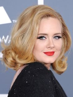 For round face: Adele's collarbone-grazing cut has a balancing effect: The fullest part of a round face is at the cheeks, so keeping the weight at the ends of strands enhances angles along the jawline.
