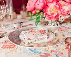 Fresh-cut peonies complete the table