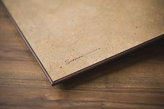 Brown Cork Endpaper. This also showcases a studio logo imprinted on the inside front cover. (Source: http://www.sassaniphotographyblog.com/2012/04/new-customizable-albums/)