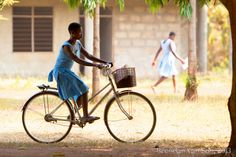 "A girl riding a bike from school in rural Ghana. ""Now this is what it's about - bikes4Africa getting children to school by bike."" Thanks to Bryony for sharing this pin. MAKETRAX.net - bikes 4 AFRICA"