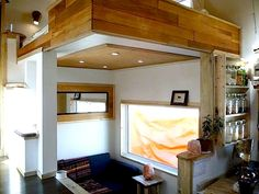 Leaf House on wheels interior view - great idea for living room nook, side closest could have pull down projector
