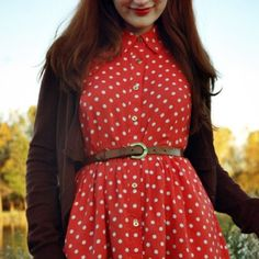 Perfect Picnic Dress This polka dotted dress is a classic cut. Light weight flowy fabric gives it a great silhouette. Buttons up the chest. Tag was cut out but I'm pretty sure it's a medium. Mannequin set to a size 6. Dresses