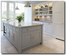 Paint kitchen white with island french grey. Marble top to island. Soft black bench tops against white good contrast.