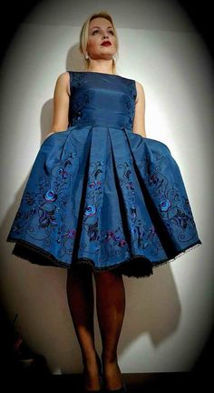 Blue dress with embroidered skirt.