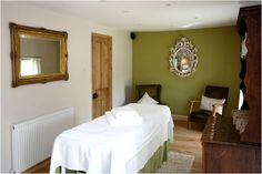 Peaceful room with natural elements and earthy green wall. My new treatment space has this colour wall.