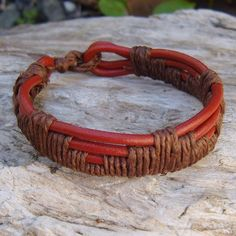Four+strands+of+brick+red+3mm+cord+woven+with+natural+hemp+cord.+This+Woven+Red+Leather+and+Brown+Hemp+Bracelet+is+adjustable,+fits+7-9+inch+wrist+and+is+.75+inch+wide.