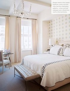 Greek key trimmed bedding, accent wall behind bed, draperies, ceiling, bench