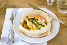 I need to cook more with parchment: Shrimp, lemon, potatoes, and herbs. Simple but looks oh so delicious!