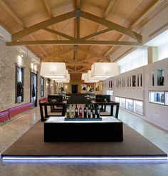 Google Image Result for http://retaildesignblog.net/wp-content/uploads/2011/10/Marques-de-Riscal-wine-store-by-Marketing-Jazz-03.jpg