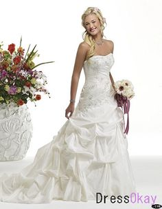 It is a sweet wedding dress throughout refined embroidery on the tight bodice .The silhouette is in a ball style throughout large folders. This strapless wedding gown gathers all sexy and luxury elements. The entire design is sexy and elegant . It is Check out too! http://fashioncentris.com