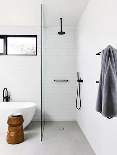 light grey matte flooring + white tiles Clean lines and an expert blend of tiling and textures create interest in this black-and-white bathroom in a Mornington Peninsula Home by Planned Living Architects. Laundry In Bathroom, Bathroom Renos, Master Bathroom, Bathroom Cabinets, Bathroom Remodeling, Dyi Bathroom, Window In Bathroom, Window In Shower, Shower Bathroom