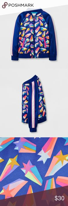 New CAT & JACK Girl's Shooting Star Bomber Jacket Let your star show off her personality with this shooting star-patterned Full-Sleeve Bomber Jacket from Cat and Jack. Brightly colored stars shoot across the blue jacket for a bold front, while stripes down the sleeves give it a sporty, track jacket feel. This lightweight jacket will look great paired with jeans and a tee and bright sneakers, or used as a warm-up jacket worn over a tank top with athletic shorts.  size L (10/12) condition: new…