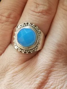 This is a handmade sterling silver ring with a beautiful sky blue Chalcedony stone. This ring has beautiful sky blue/aqua hue. This beautiful ring weighs grams and is size Ruby Jewelry, Gypsy Jewelry, Handmade Sterling Silver, Sterling Silver Pendants, Chalcedony Stone, Rainbow Moonstone Ring, Natural Stone Jewelry, Blue Rings, Statement Rings