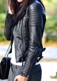 Black leather shirt, white shirt, charcoal grey slacks, quilted black purse.