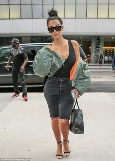 Daring duds:This entry comes after Kim was seen in a sexy black tank top…