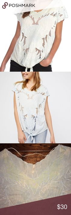 Free People Castaway Cutout Top Go far and away in Free People's beach-inspired design. A standout, cutout seashell design and high/low hem instantly transport your look. Soft V-neck with colored Embroidered accents, cutout seashell design at front. Cap sleeves, cutout mesh inserts at front. Front tie accent. Knit back. High/low hem,  back-hem vent, pullover style. Sky blue color.  Lyocell and Linen blend. Machine wash. Made in India. Excellent, lightly used condition. TR Free People Tops