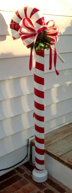 Pvc candy canes my husband made christmas porch, christmas wreaths, christm Christmas Yard Decorations, Christmas Porch, Christmas Candy, Winter Christmas, Christmas Lights, Christmas Holidays, Christmas Wreaths, Christmas Ornaments, All Things Christmas
