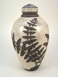 raku pottery hand carved white crackle urn with fern frond