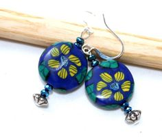 Hand crafted from polymer clay, these sunny polymer clay earrings feature slices of my own original  polymer clay cane work.  For those who have never heard of cane work and polymer clay, here's a bri