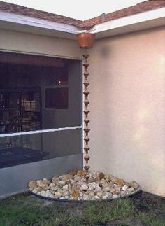 rain chain idea - need to add an overflow tube to get the water away from the house
