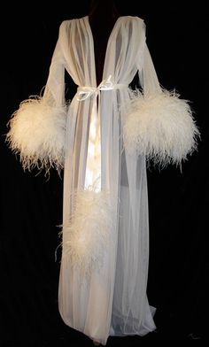 ** I think need one of these,it might change my whole world! :) ::: Faire Frou Frou ostrich feather robe