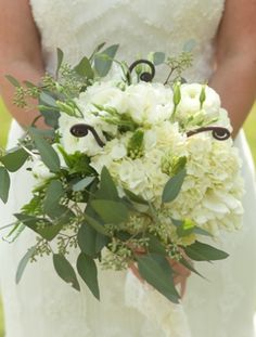 loose and romantic bouquet...Seeded Eucalyptus, hydrangea, ranunculus, and fiddlehead fern curls  #weddingbouquets #weddingflowers