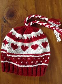 Love is in the air…. Well… Knitted hearts are in the air anyway. 3 new heart designs this week alone! Here is the first: a red and white ski style beanie decorated with mountains, snow …