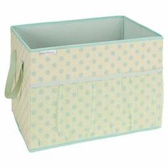 "Canvas trunk organizer with a mesh pocket and polka dot motif.   Product: Trunk organizerConstruction Material: Canvas and meshColor: Turquoise and cream Features: Outside mesh pocket Dimensions: 12"" H x 18"" W x 12"" D"
