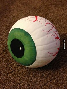 painted eyeball pumpkin for autumn or fall or halloween