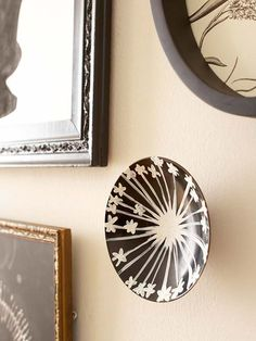 "When creating your own ""galaxy"" on the wall, pay special attention to shape. This technique works particularly well with pieces of varying shapes and sizes. Incorporate round or oval pieces to give your collection visual interest."
