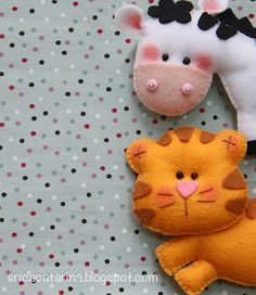 Cute little felt friends. Lots of ideas on this Brazilian blog, but I don't see any patterns.