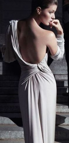 This dress relates to the curved and dynamics board because of how it transitions in the middle and spills out in different contrasting directions, and sweeps upwards to the shoulder  Donna Karan