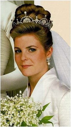 Serena Stanhope, wearing the lotus tiara, loaned by her mother-in-law, Princess Margaret, when she and David, Viscount Linley married on 8th October 1993. The lotus tiara wasn't included in the sale of Princess Margaret's jewels in 2006, and has since been spotted being worn at a Palace event by Katherine, Duchess of Cambridge in 2013..