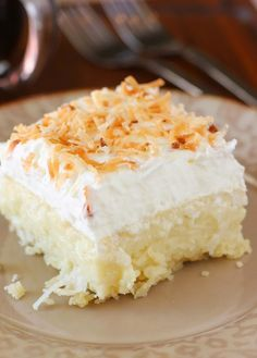 Coconut Cream Pie Bars ~ they are HEAVENLY: creamy coconut, a cloud of whipped cream, and a buttery shortbread crust. It doesn't get better than this for a coconut fan..