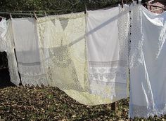"""Soak vintage linens in """"soaking magic""""(a mixture of Biz, Cascade and Clorox Colorsafe Bleach) ...takes most stains out, then hang in sunshine to dry."""