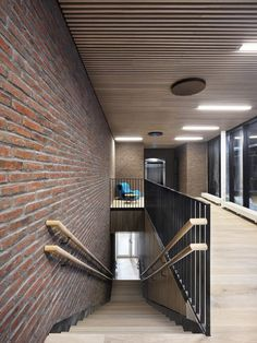 Red-brick boxes pop out of A-Lab's narrow office block on Oslo waterfront Oslo, Space Interiors, Office Interiors, Brick Interior, Interior Design, Fire Escape, Brick Facade, Red Bricks, Ceiling Windows