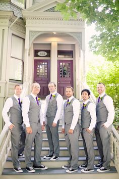 groomsmen in gray suits, I even kind of like the shoes but thats not how my guys are.  lavender ties.