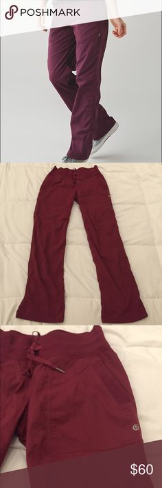 Lululemon Red Studio Dance Athletic Pants Cute pair of dark red Lululemon full length studio pants. They have faint pinstripes down the leg. Nice open pockets ok the front and cute Lululemon drawstrings. Logo on the front of the leg. Size 6 in great condition. No signs of wear lululemon athletica Pants Track Pants & Joggers