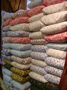 Feedsacks, or flour sacks, as they would have appeared in the local store, full of flour or animal feed. Cloth was saved and used to make clothing, aprons, towels, etc.  Then the clothing, when too small or torn/worn to re-use, was made into quilts.