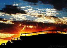 Denver Bronco Sunset behind the Broncos stadium. Maybe we can actually use our season tickets this season!