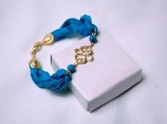 Gold filled Oriental Charm Bracelet with Turquoise Silk by Myvera