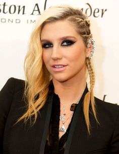 I love Kesha, but the necklaces make her look like she's in the illuminati.