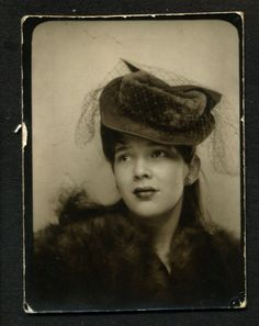 Vintage photo booth, young woman with hat