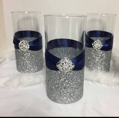 Wedding Centerpiece, (1) silver glitter vase, navy blue wedding theme, bridal shower centerpiece, glitter vase, wedding decorations. Vase is 7 tall decorated with silver glitter , navy blue ribbon and a brooch. Perfect for a navy blue wedding theme, ribbon and glitter can be changed to