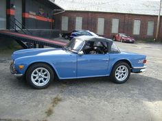 1974 Triumph TR6 convertible...and I would call her Susie, the little blue coup :)