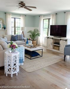 I am loving this modern farmhouse living room with coastal accents. The media console from HomeGoods is perfect! (sponsored) See how to install these Gorgeous Engineered Hardwood floors in Fairbanks Maple Dust.