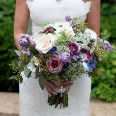 Gina's textured bouquet was filled with purple and white Queen Anne's lace, garden roses, ranunculus, lilacs, lavender and brunia berries.